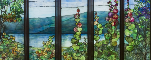 Stained glass view of a lake and flowers