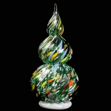 A blown glass green tree with specks of orange, white, and yellow