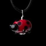 Red and black ladybug glass bead on a black necklace