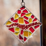 glass suncatcher with yellow, red, and orange glass tiles