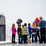 Group of children in the New Glass Now Exhibit