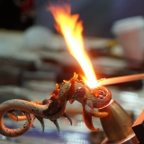 Close up of an artist using flamework