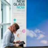 Woman looking at iPad while in the New Glass Now gallery