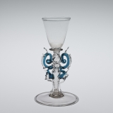 Clear glass goblet with elaborate crimped blue and clear glass swirls on the stem of the glass