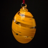 A clear and orange striped glass glass ornament