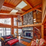 Inside view of a log cabin with high ceilings